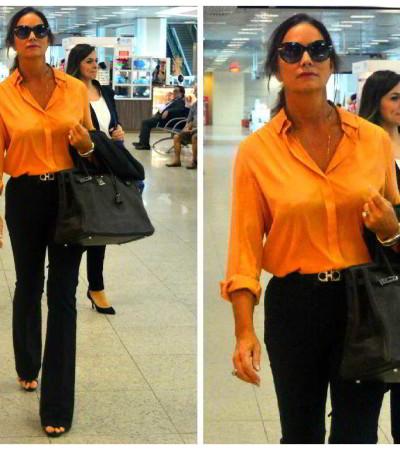 Inspiração da semana: calça preta e camisa laranja de Luiza Brunet