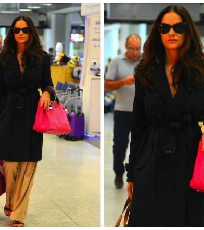 Inspire-se: Luiza Brunet usa trench-coat preto e calça caramelo