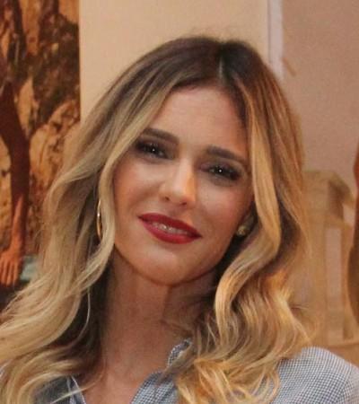 Fernanda Lima veste pantacourt e calça branca