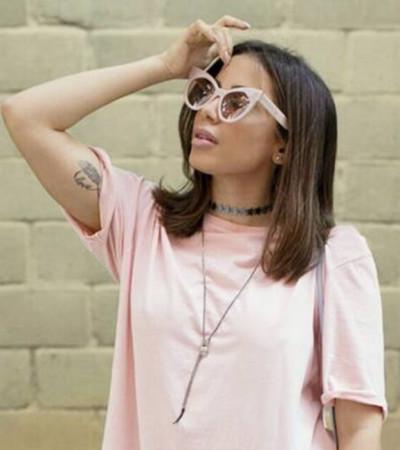 Anitta usa bota Givenchy de R$ 8,5 mil com vestido-camiseta